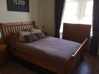 Double wooden sleigh bed and Silent Night Mattress