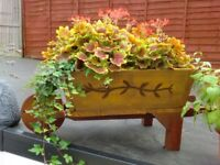 Wooden wheelbarrow flower planter