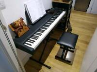 Korg B1 with seat, stand, pedal, headphones and two books