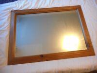 Oak frmed wall hanging mirror