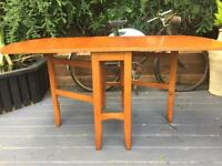 A MID-CENTURY DROP LEAF TEAK DINING TABLE IN GREAT PRE-LOVED CONDITION, FREE LOCAL DELIVERY