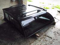 Hard top canopy for Nissan Navara. Black, dark glass all round. In good order.