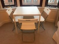 White IKEA Table with 3 Foldable Chairs