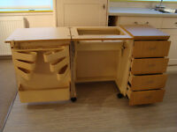 Sewing machine cabinet with air lift, 4 drawers, many compartments + castors. Very good condition..