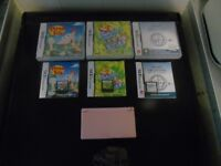 DS LITE PINK CONSOLE WITH GAMES AND MAINS CHARGER.