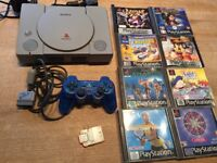 Playstation 1 Sony plus controller and 8 games