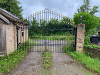 pair of black and gold wrought iron driveway gates