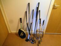 Bundle of sports equipment (golf,tennis,hockey)
