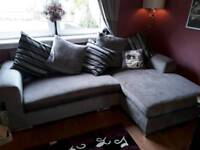Grey corner chaise sofa with silver chrome finish