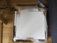 2 boxes of white ceramic floor tiles 338x338 .Unopened in box.Left over from bathroom tiling.