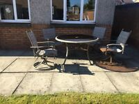 Garden table and 4 swivelling chairs.