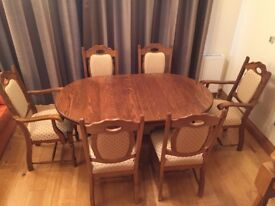 Beautiful solid oak extending dining table and 6 chairs, excellent condition, well looked after