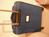 New Blue suit case on 4 wheels with expanding zips