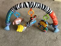 £1. Clip on frame for bouncer with toys.