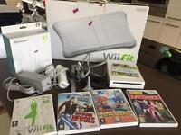Nintendo Wii + Wii Fit + Sports Accessory Pack + 3 games.