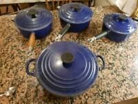4 le creuset blue pans
