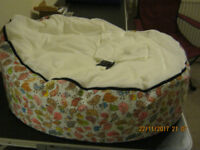 baby bean bag with 2 zip on covers 1 with the safety strap