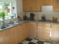 Cavendish kitchen: shaker solid light oak base and wall units, double oven and fitted fridge.