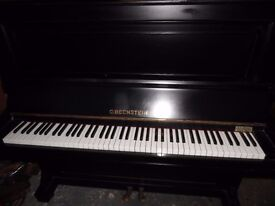 upright piano by c bechstien