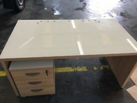 Glass topped desk with side table