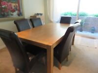 Solid Oak table with leather chairs
