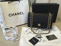 Chanel 2.55 bag. Genuine black lambskin leather.
