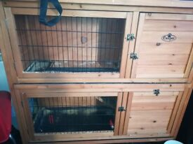 4ft wooden hutch, great condition, never been used outdoors, has sliding trays and opening lid