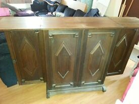 Wood bar solid. Extends out and has lots of storage space
