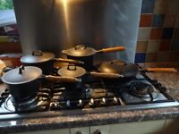 Set of cast iron saucepans with wooden handles