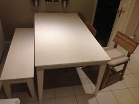 Dining table, bench and three chairs. IKEA.