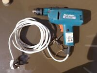 Black and Decker corded D143 Electric Drill with hammer option