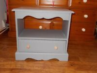 Grey/pine bedside table with one draw. Measures 52cm height x 58cm width x 38 cm depth