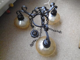 used. wrought iron. ceiling light. with bulbs and shades.