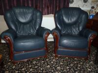 A pair of leather Arm Chairs