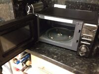 Selling Black Russell Microwave Oven for £30
