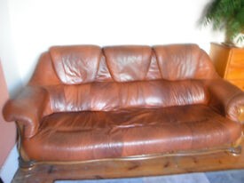 Leather Sofa, mid tan brown, seats three to four, good condition.