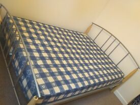 Metal frame bed with mattress, two bedside cabinets, wardrobe and drawers