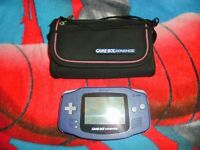 Nintendo GameBoy Advance with 21 boxed games.