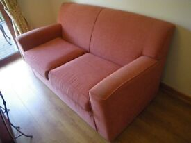 M & S TWO - THREE SEATER SOFA. PALE TERRACOTTA DRAYLON FABRIC. VERY GOOD CONDITION.