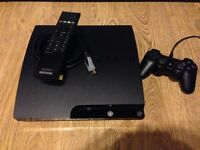120Gig PS3 complete with Controller, Camera, Blu-ray Remote, Guitar and 30 Games.