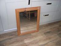 A pine framed rectangular mirror.