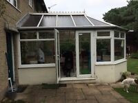 Conservatory, good condition, locking windows and french doors.