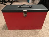 red small filing case with folders included.