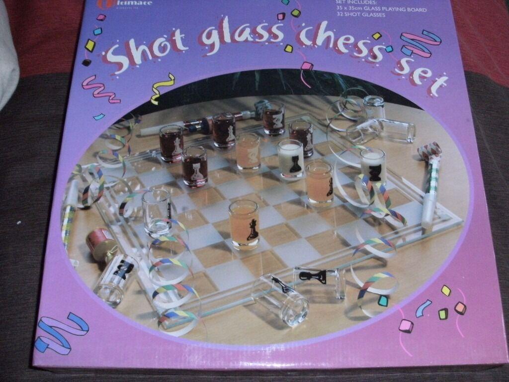 SHOT GLASS CHESS SET (NewBoxedin Longwell Green, BristolGumtree - SHOT GLASS CHESS SET (New & Boxed) • 35cm x 35cm glass playing board • 32 shot glasses
