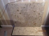 Breccia Aurora marble hearth and back panel with edging and infill