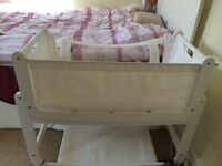 SnuzPod Bedside Crib and Mattress (White), with waterproof mattress protector and 2 bed sheets.