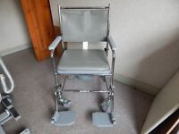 Wheel chair commode