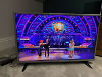 G 32 Inch HD TV . Grey frame wall mounted from new,