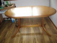 Meredew Teak Dining Table. In very good condition. 58''x37''.Extended 79''x37''
