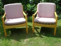 A PAIR OF ERCOL ARMCHAIRS.